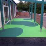 34m² light green wetpour with dark green graphics in Hampshire
