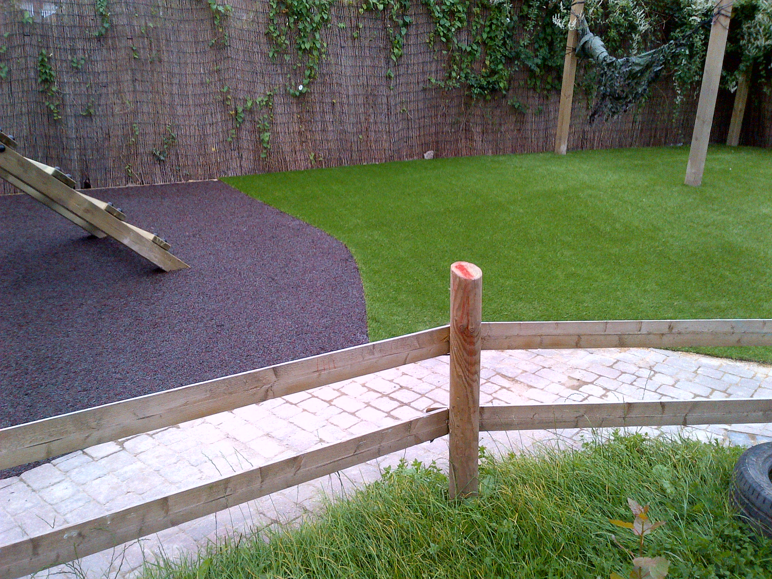 112m² bonded rubber mulch and 80m² artificial grass in Weston Super Mare